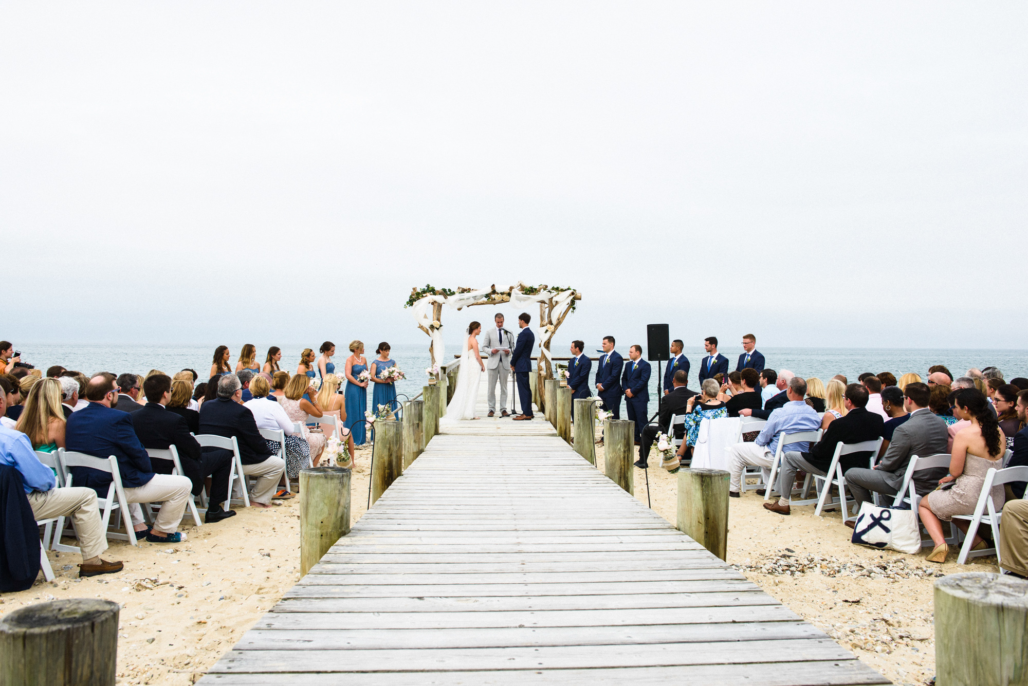 A wedding ceremony at the East Chop Beach Club  photo by David Welch Photography