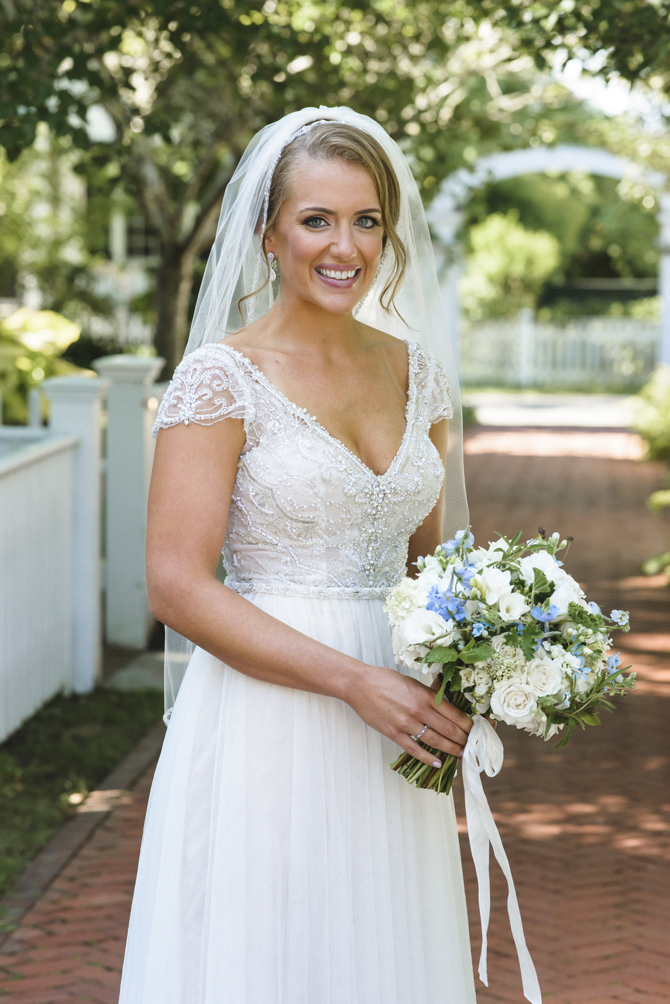 A bride holding her Morrice Florist flower bouquet at the Harbor View Hotel photo by David Welch Photography