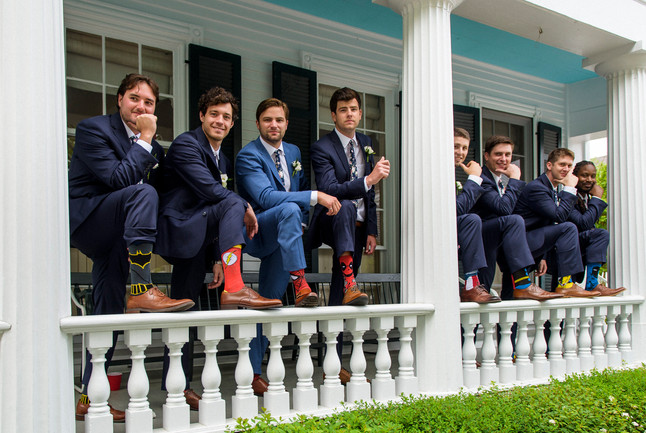 A groom and his groomsmen on the porch of the Captain Morse House in Edgartown photo by David Welch Photography