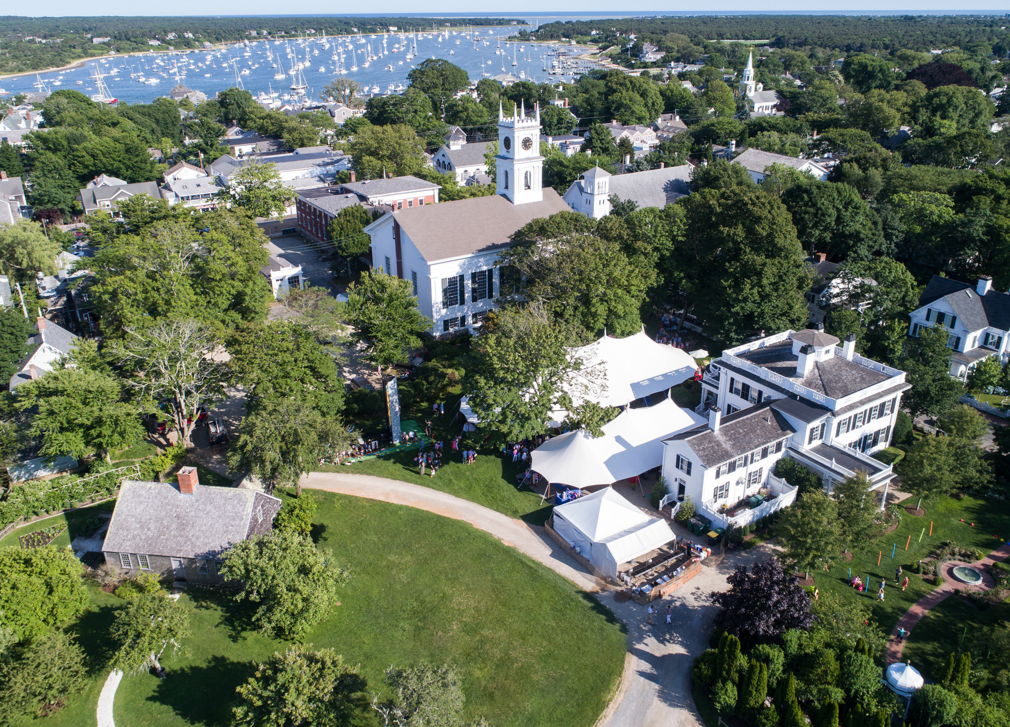 A drone photo of the Old Whaling Church and Dr. Daniel Fisher House & Gardens in Edgartown martha's vineyard wedding venues photo by David Welch Photography