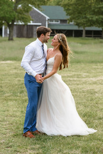 A bride and groom at the Martha's Vineyard Agricultural Society Hall in West Tisbury photo by David Welch Photography