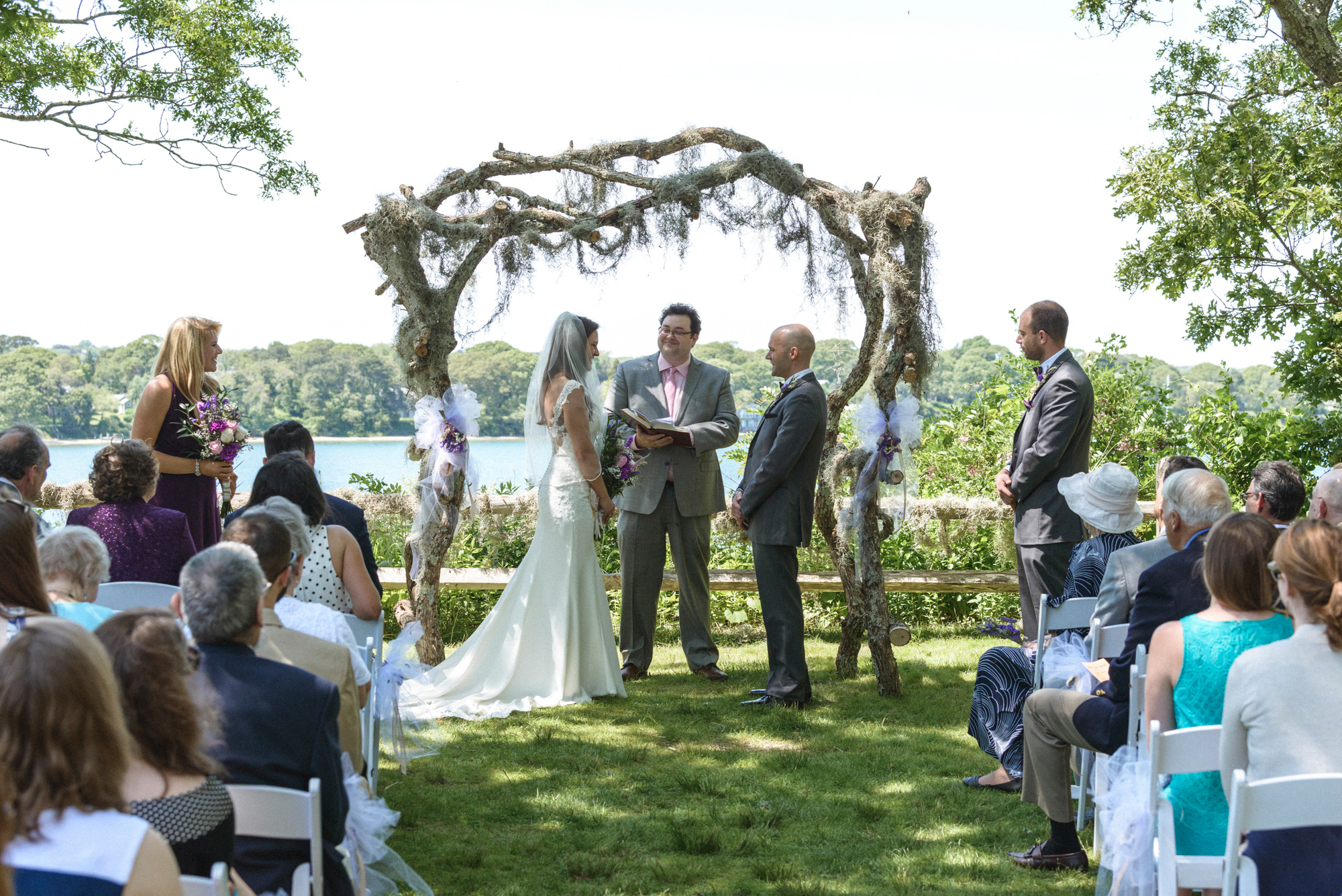 Scott and Melisa wedding ceremony at the Sailing Camp Park in Oak Bluffs photo by David Welch Photography