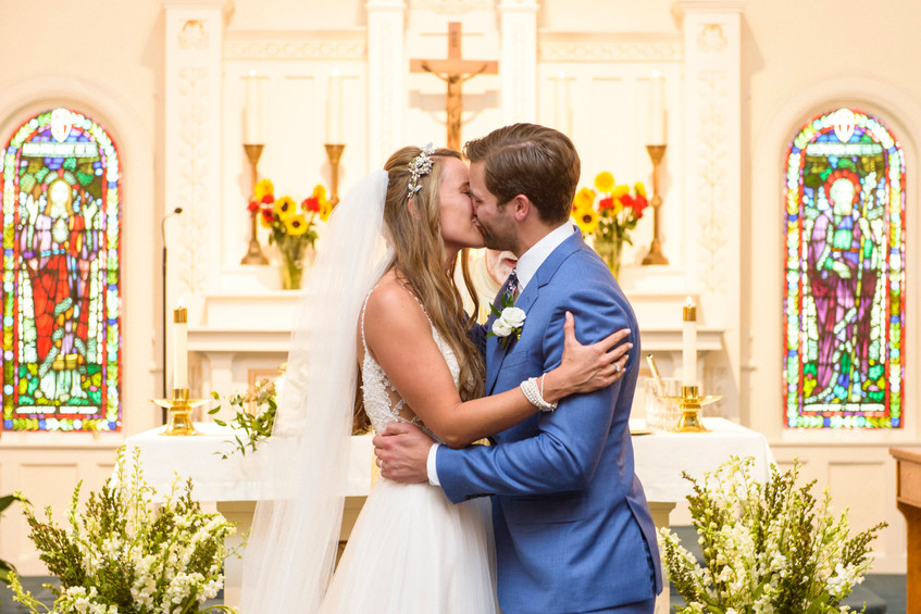 A bride and groom kiss photo by David Welch Photography