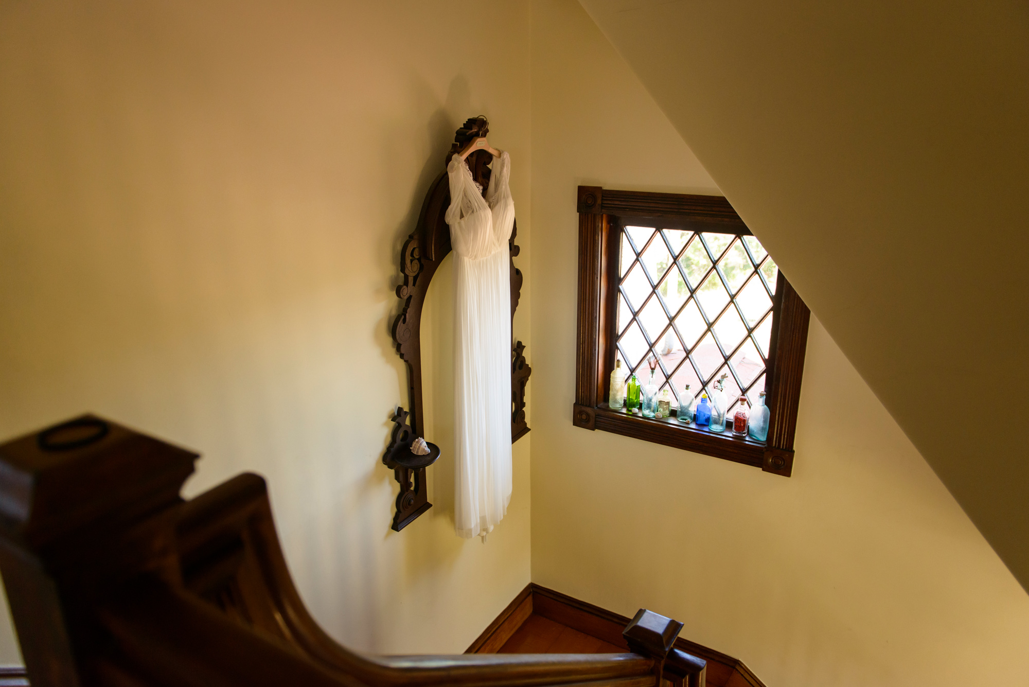 A hanging wedding dress inside the Tower House in Chilmark photo by David Welch Photography