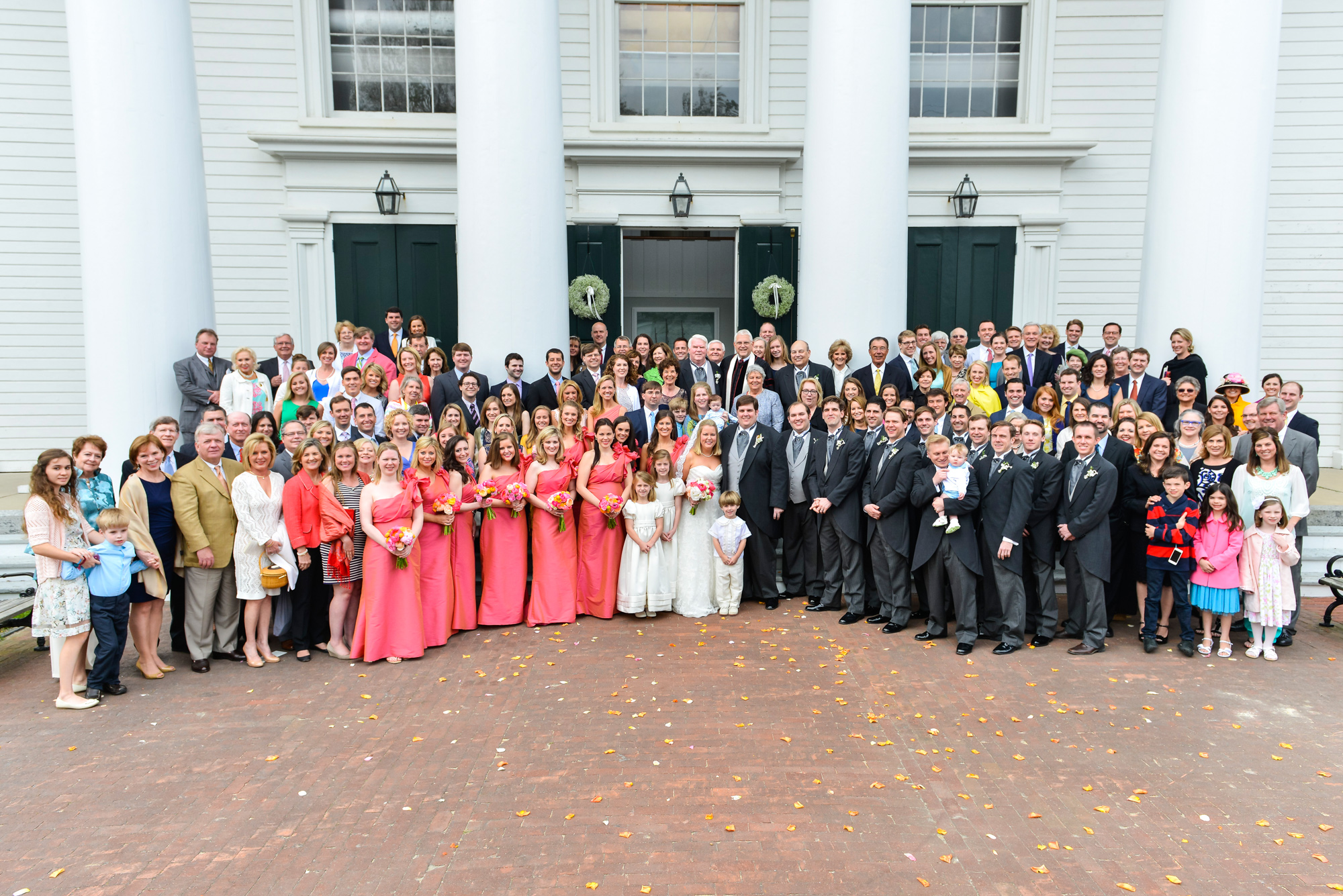 A group wedding photo outside the Old Whaling Church in Edgartown  photo by David Welch Photography