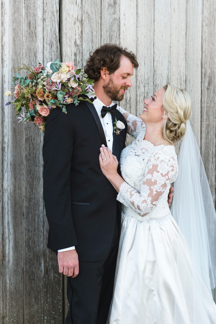 A bride and groom at Island Alpaca Company on Martha's Vineyard photo by David Welch Photography