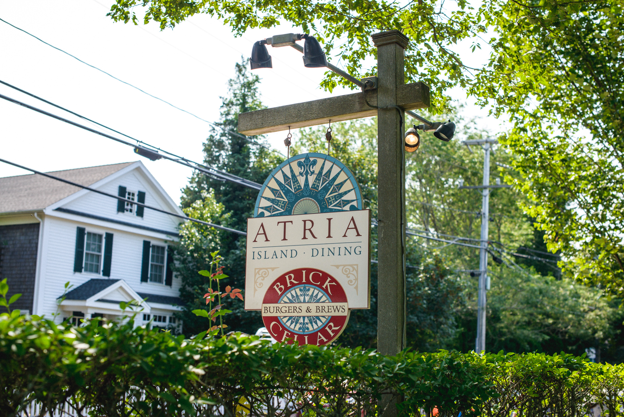The sign  at Atria Restaurant and Brick Cellar Bar in Edgartown martha's vineyard wedding venues photo by David Welch Photography