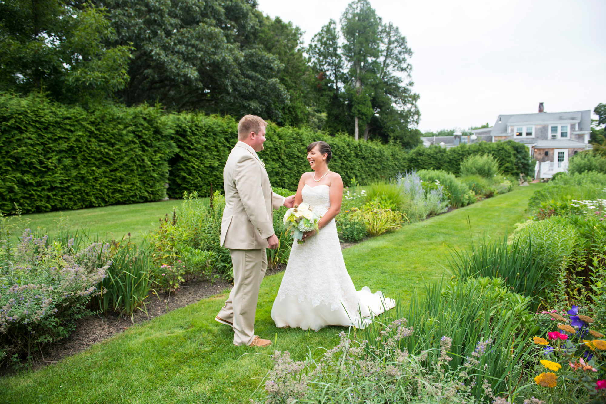 A bride and groom in the English Garden at Lambert's Cove Inn photo by David Welch Photography