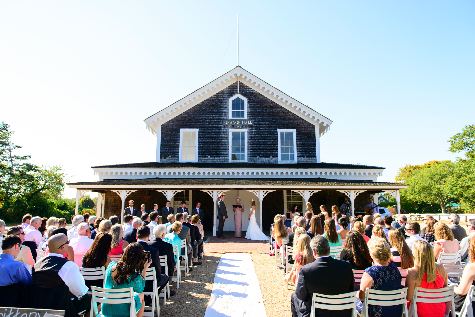 A wedding ceremony in front of the Grange Hall in West Tisbury martha's vineyard wedding venues photo by David Welch Photography