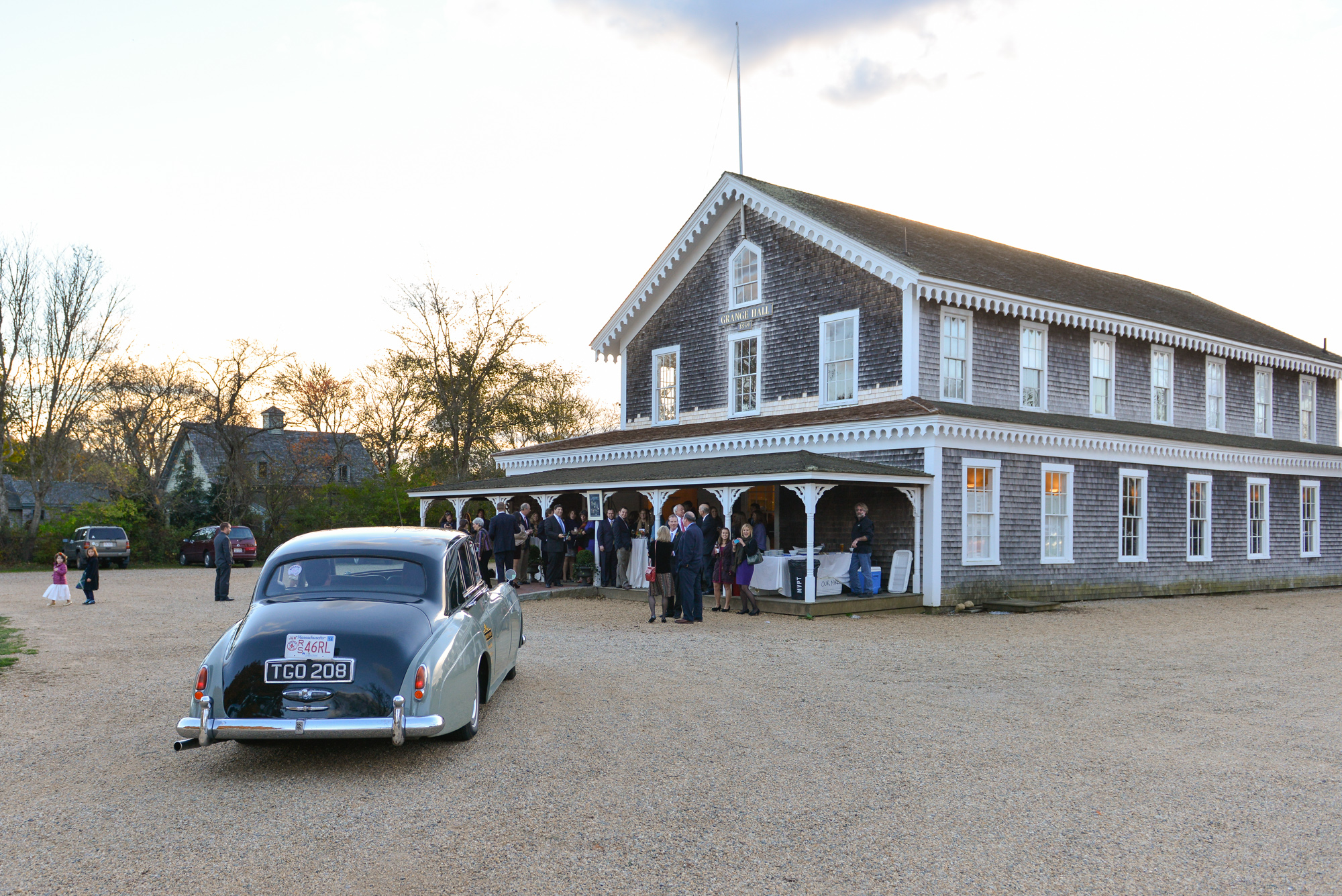 A bride and groom pull up to the Grange Hall in West Tisbury photo by David Welch Photography