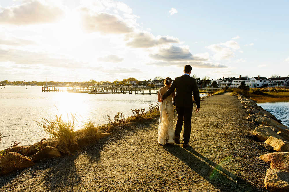 A bride and groom near the Edgartown Lighthouse photo by David Welch Photography