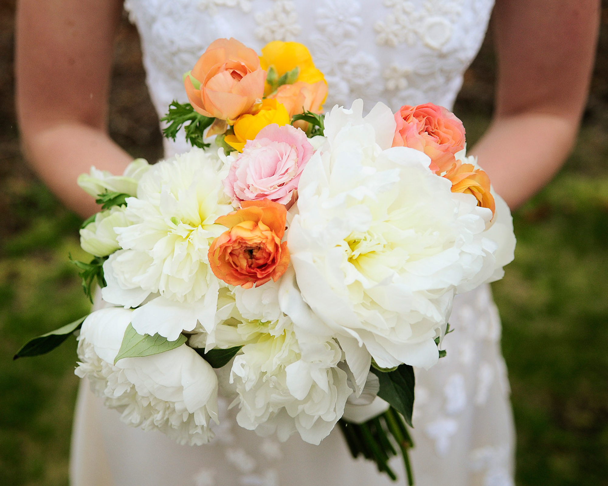 A bride and bridal bouquet at Allen Sheep Farm in Chilmark  photo by David Welch Photography