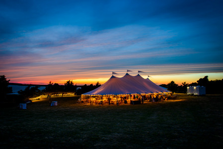 A big sky tent during blue hour photo by David Welch Photography