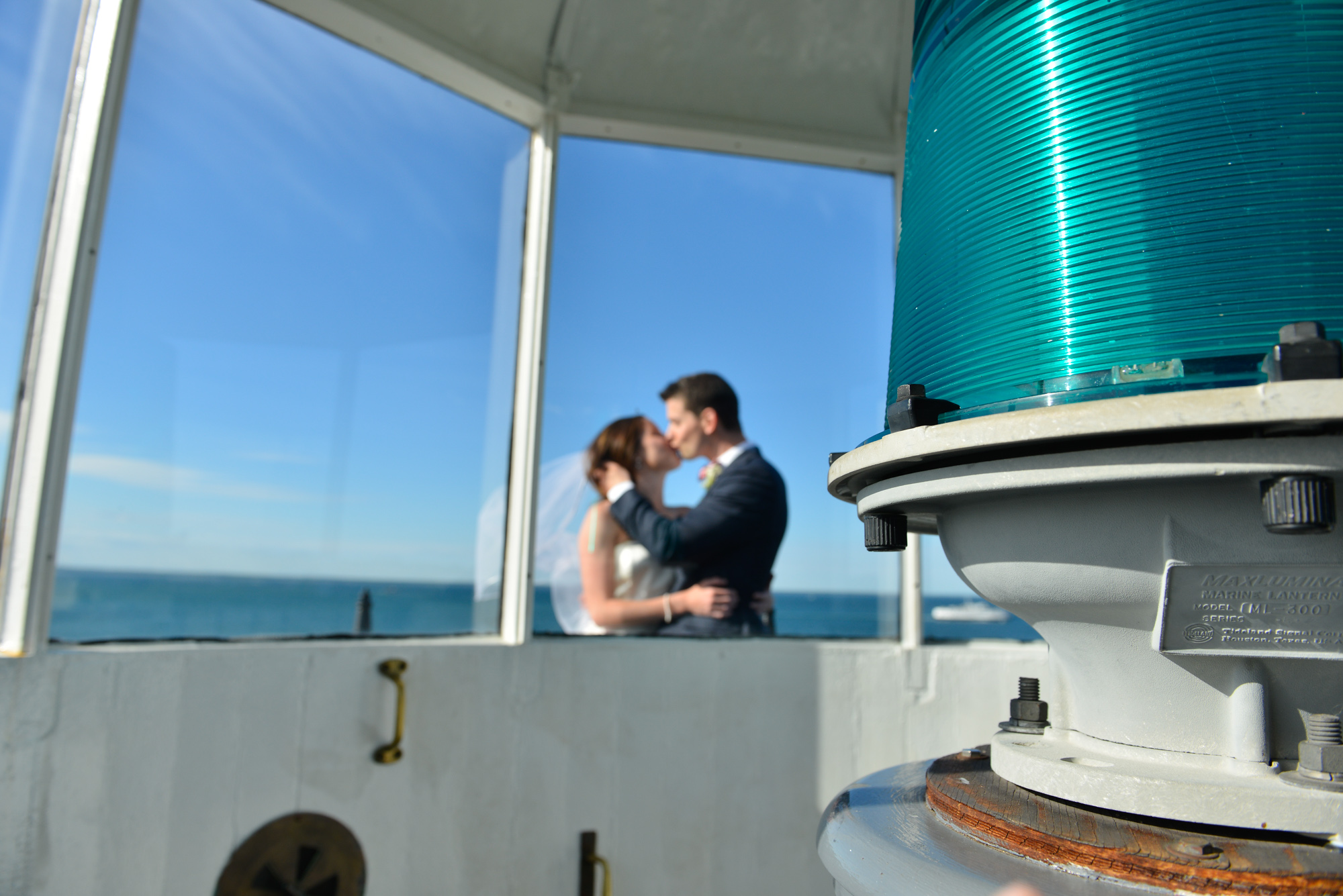 A bride and groom atop the East Chop Lighthouse in Oak Bluffs photo by David Welch Photography