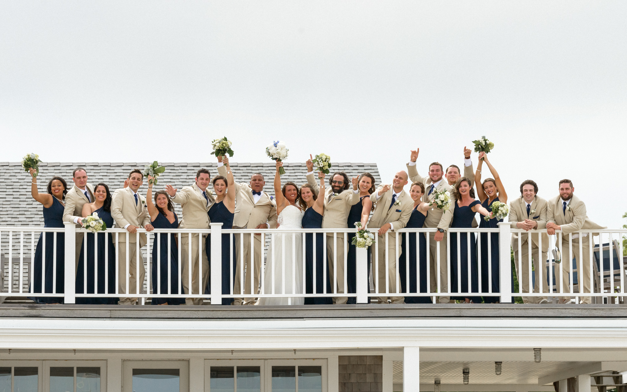 A wedding party on top of the Vineyard Haven Yacht Club photo by David Welch Photography