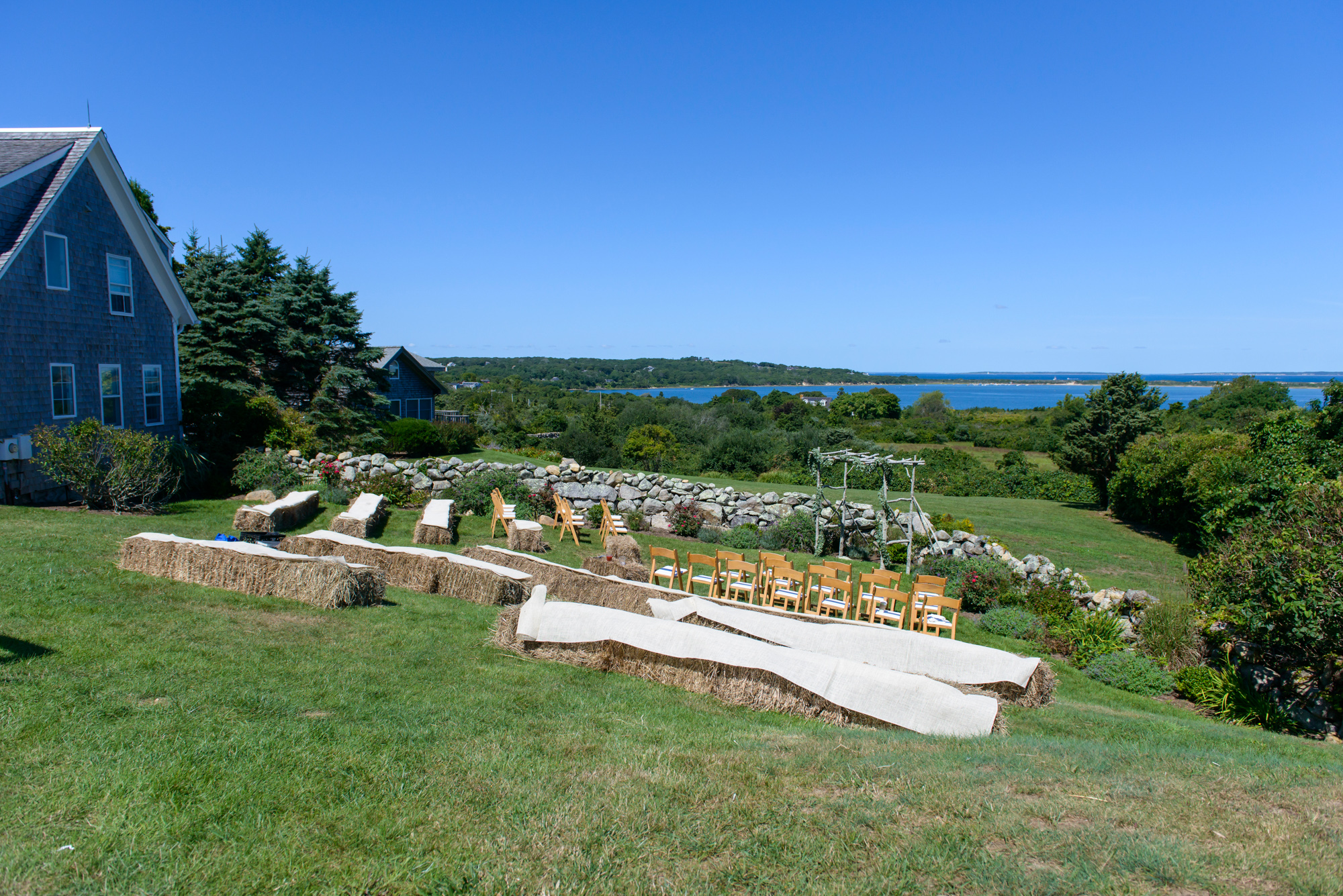 A wedding ceremony setup The Tower House in Chilmark photo by David Welch Photography