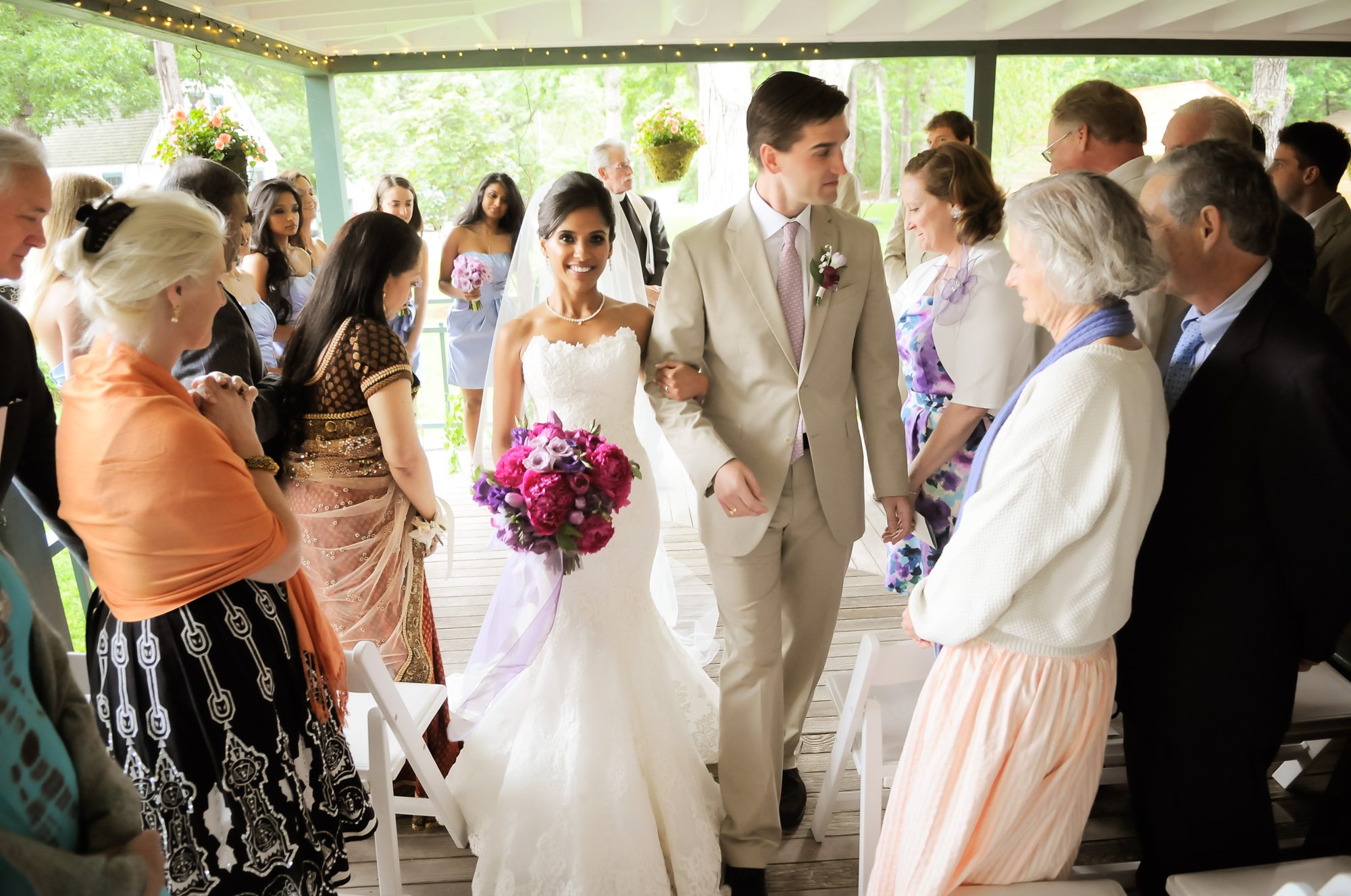 A bride and groom at a martha's vineyard wedding venues West Chop Club photo by David Welch Photography