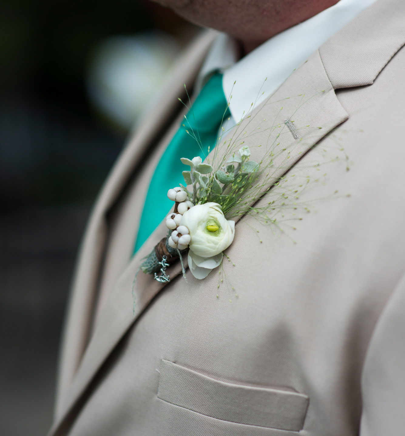 A groom boutonniere at Lambert's Cove Inn photo by David Welch Photography
