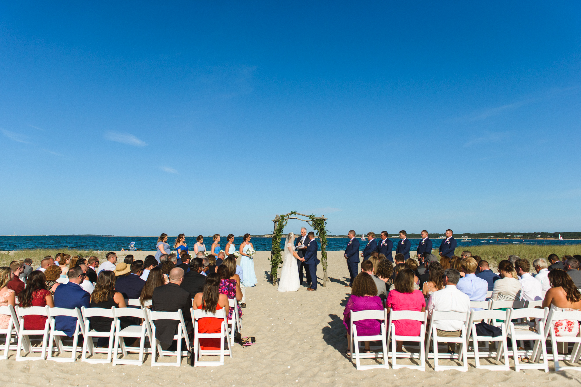 A wedding ceremony the Edgartown Lighthouse photo by David Welch Photography