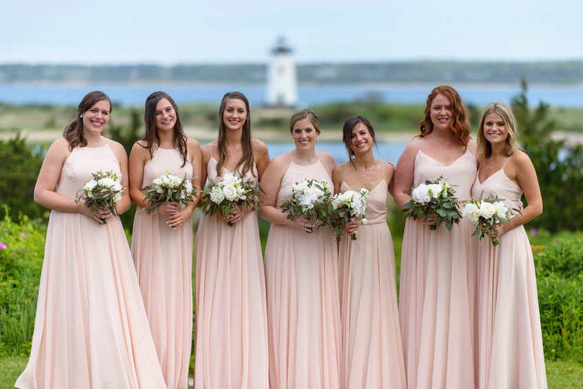 A group photo of bridesmaids near the Edgartown Lighthouse photo by David Welch Photography