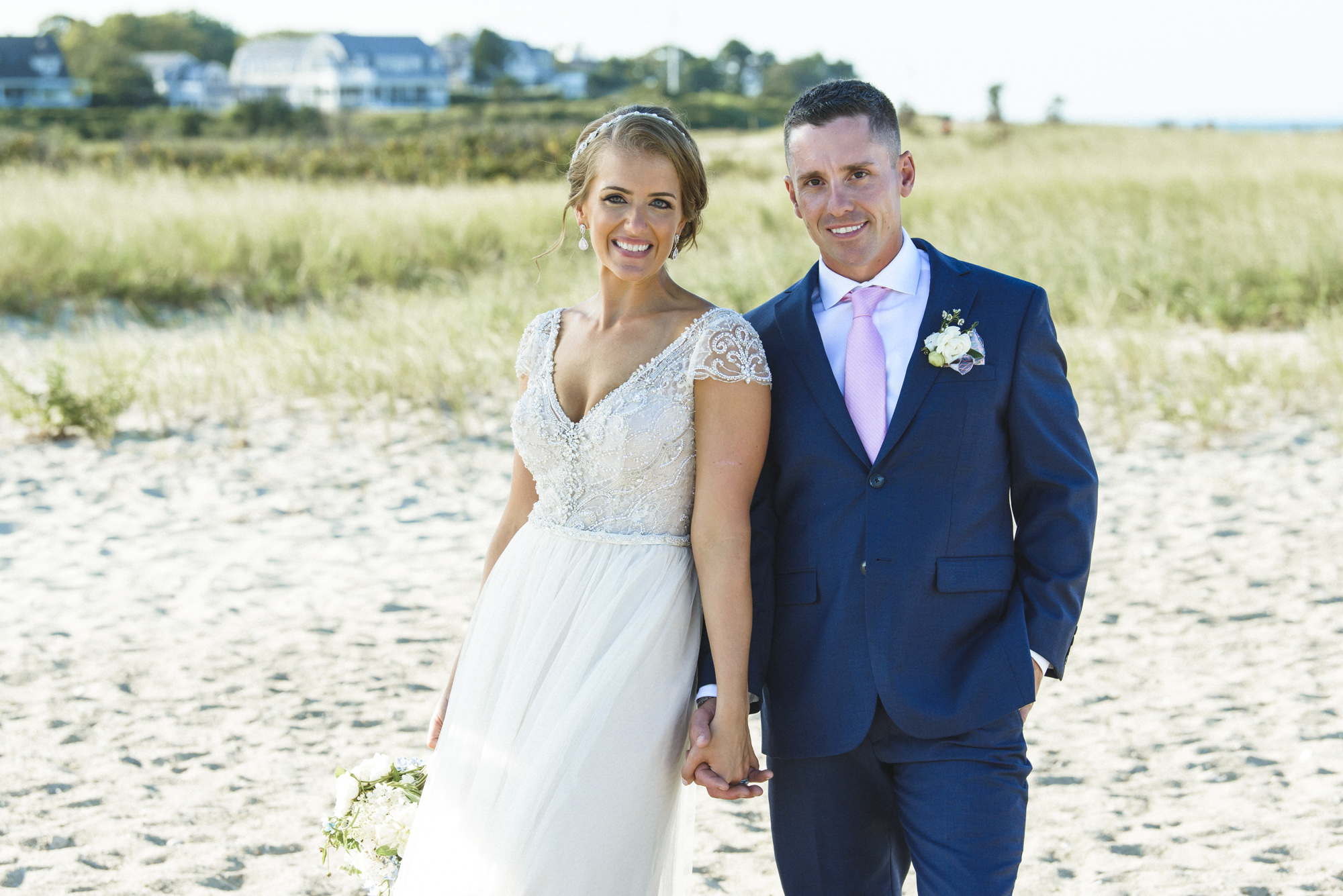 A bride and groom next to the Edgartown Lighthouse photo by David Welch Photography