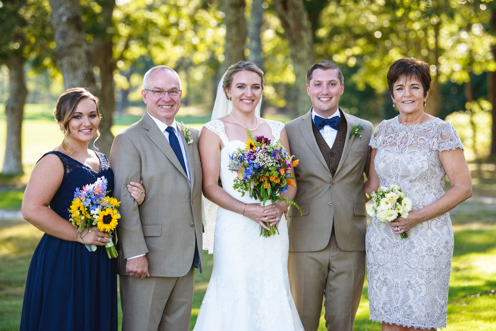 Formal family wedding photos on the grounds of Farm Neck Golf Club  photo by David Welch Photography