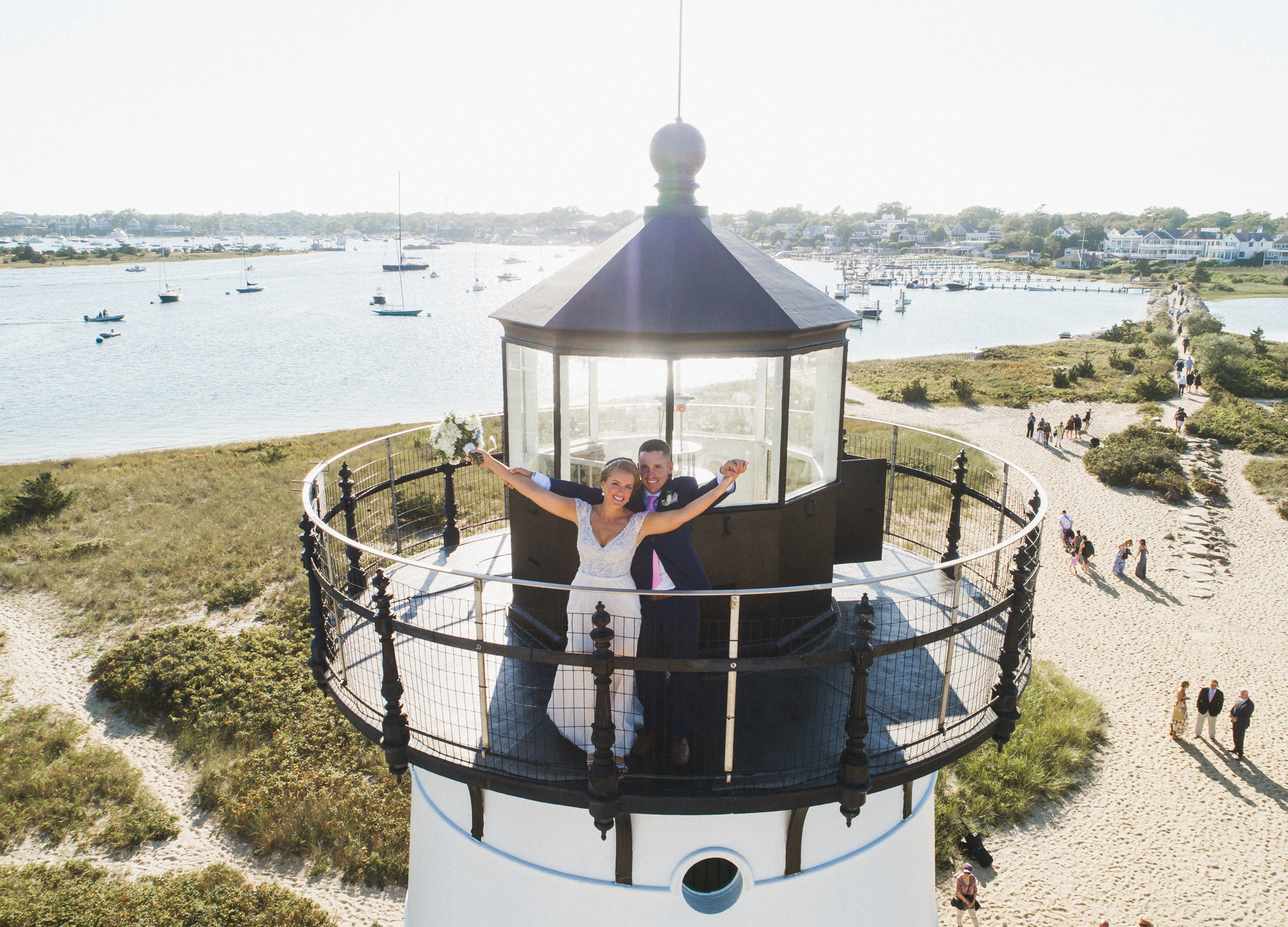 A drone photo of a bride and groom atop the Edgartown Lighthouse photo by David Welch Photography