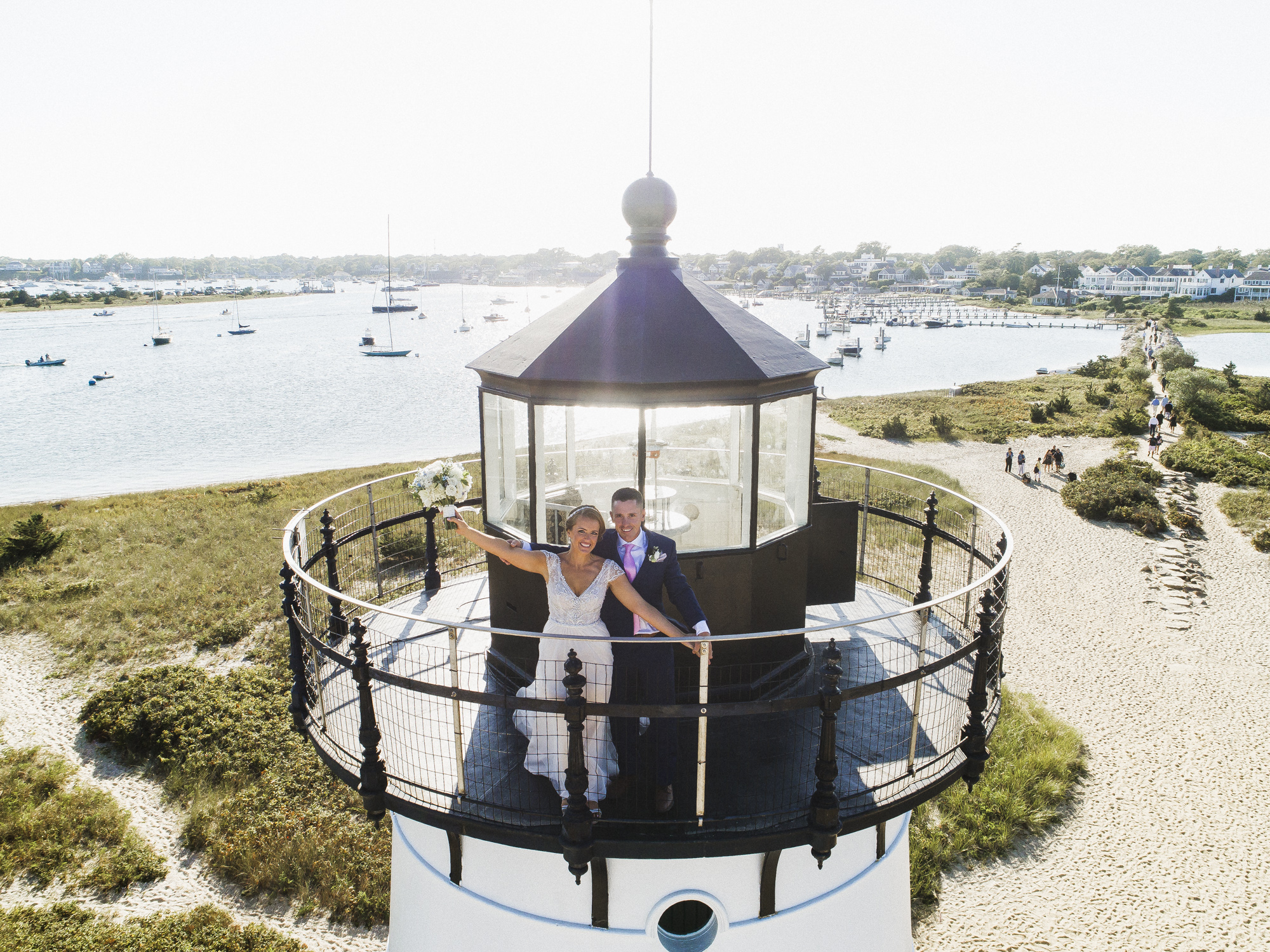 A bride and groom on top of the Edgartown Lighthouse photo by David Welch Photography