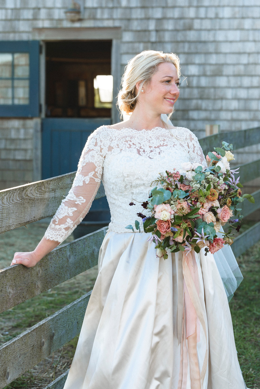 A bride with her bridal bouquet at Island Alpaca Company on Martha's Vineyard photo by David Welch Photography