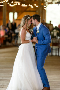 A bride and groom have their first dance at their wedding reception photo by David Welch Photography