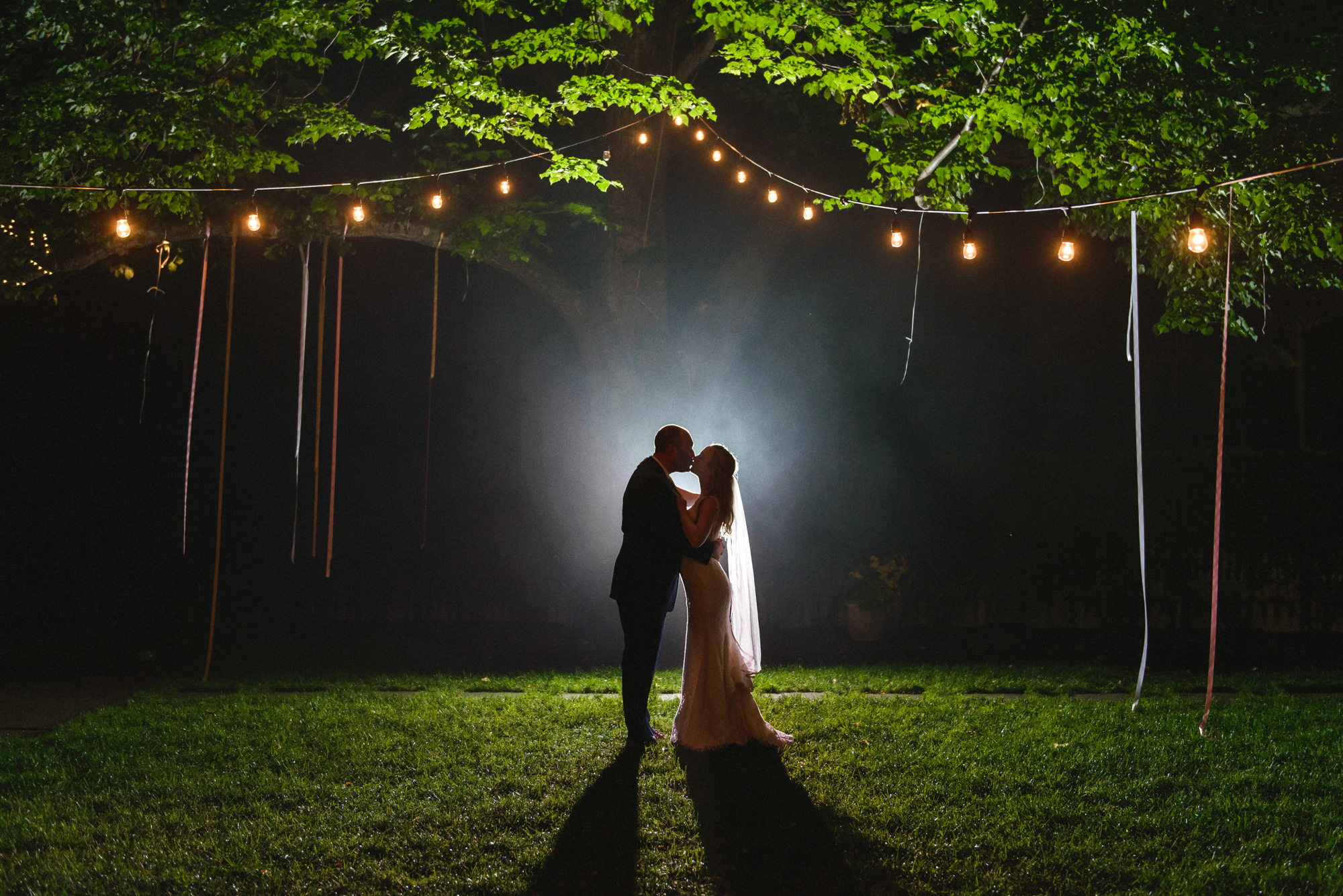 A magical photo of a bride and groom at Atria Restaurant and Brick Cellar Bar in Edgartown photo by David Welch Photography