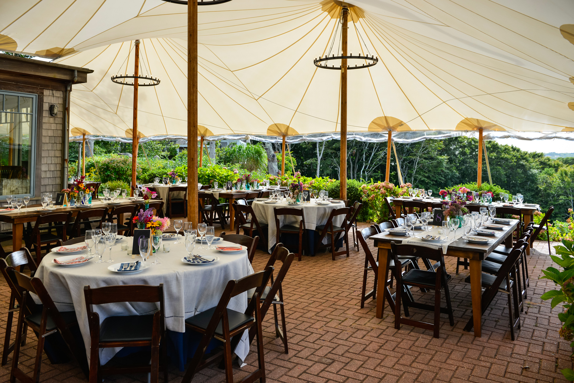A wedding reception setup under a tent at The Beach Plum Inn & Restaurant photo by David Welch Photography