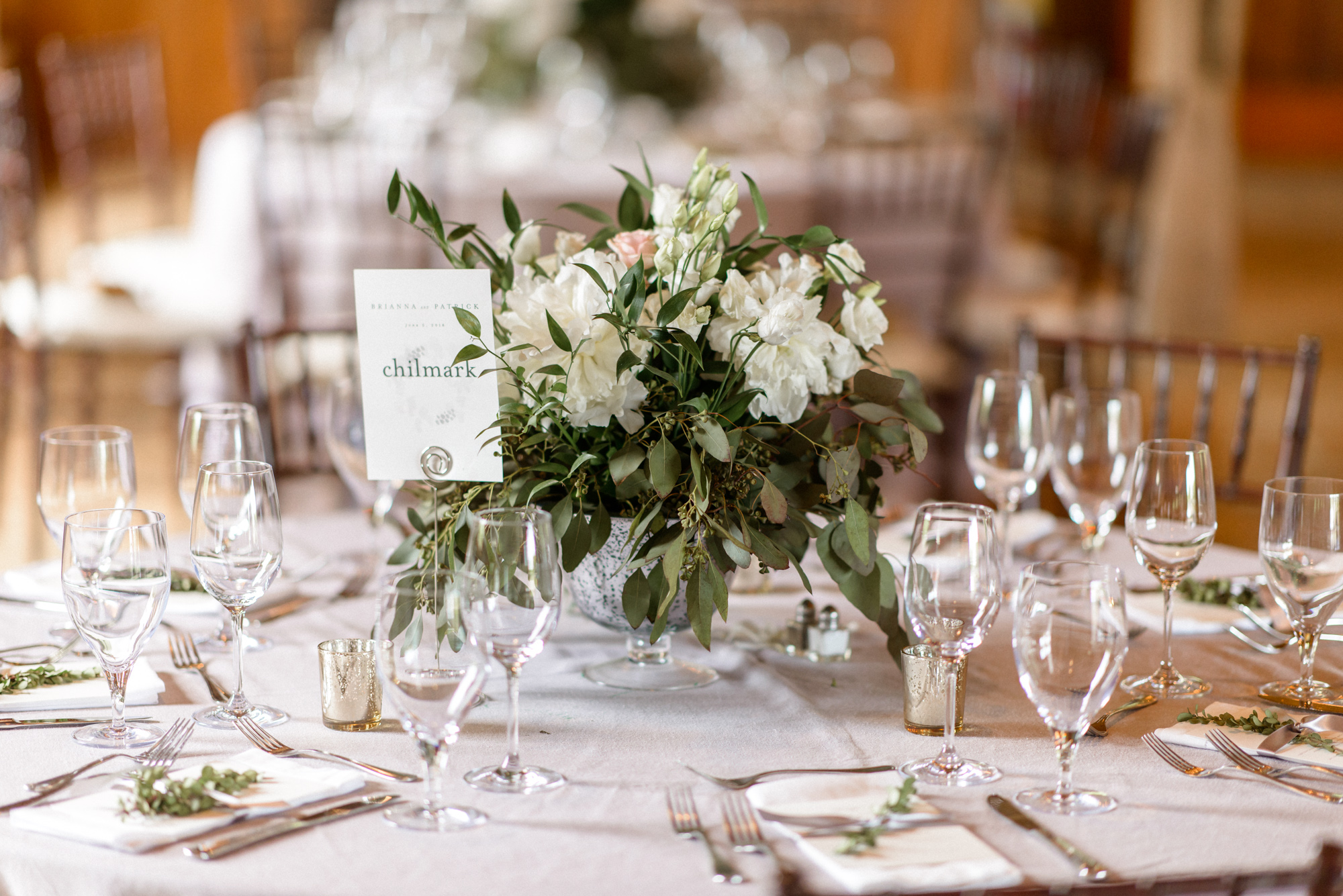 A wedding tablescape at the Martha's Vineyard Agricultural Hall in West Tisbury photo by David Welch Photography