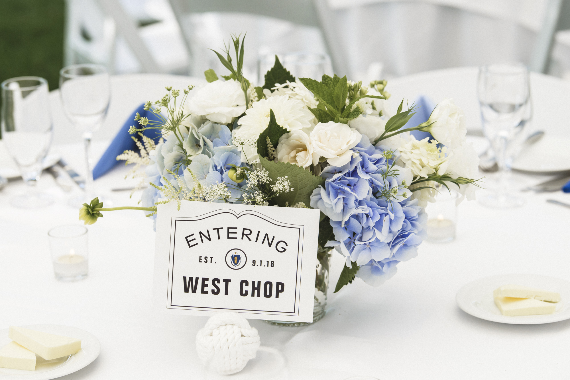 A wedding tablescape with flowers by Morrice Florist at the Harbor View Hotel on Martha's Vineyard photo by David Welch Photography