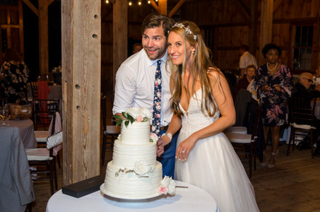 Cake cutting A wedding reception dance party at the Martha's Vineyard Agricultural Society Ag Hall photo by David Welch Photography