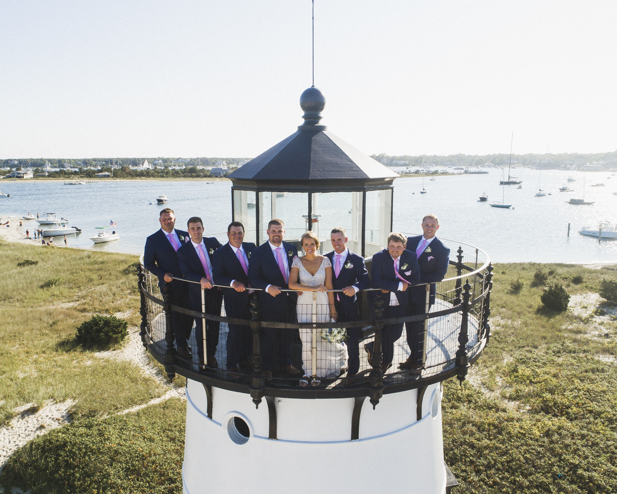A drone photo of a wedding party on top of the Edgartown Lighthouse photo by David Welch Photography