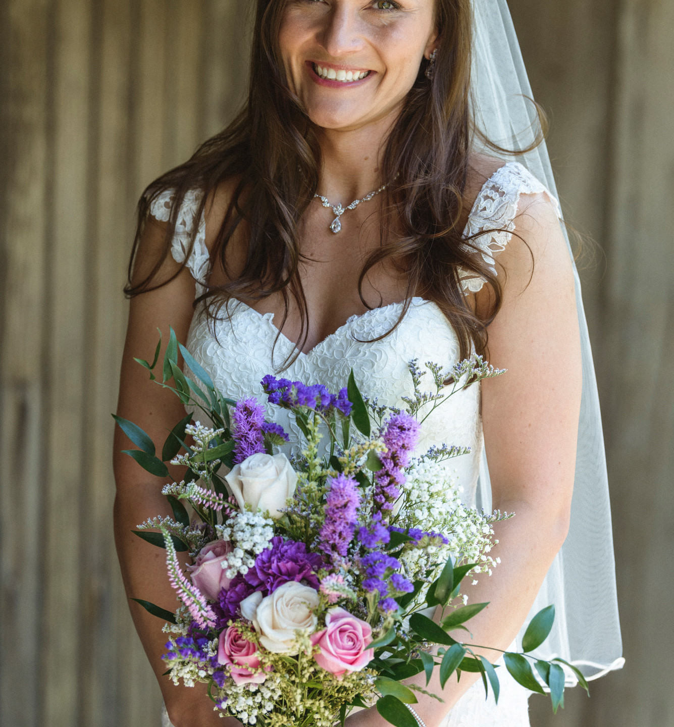 A bride holding her bridal bouquet at the Sailing Camp Park in Oak Bluffs photo by David Welch Photography