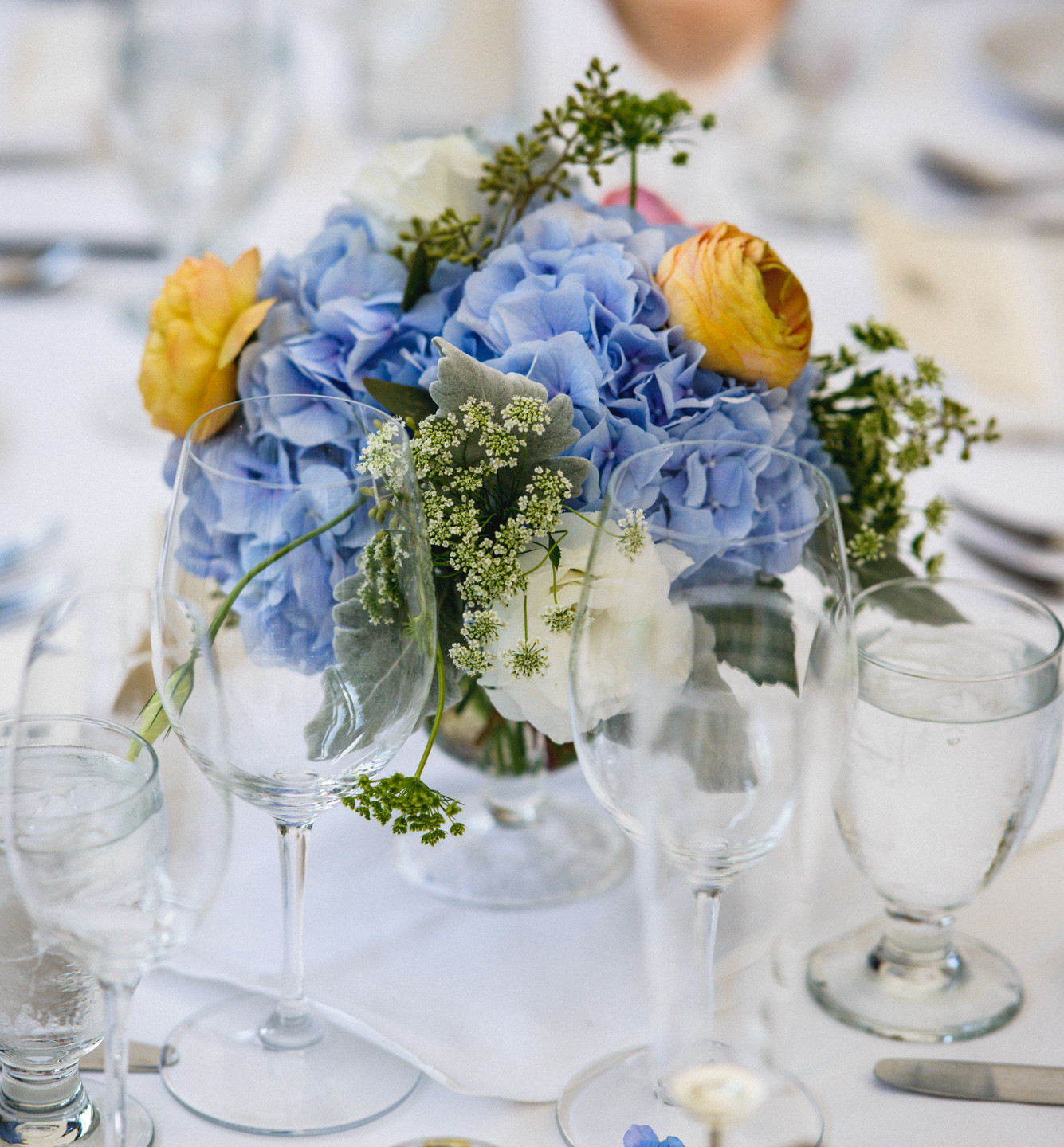 A wedding tablescape  at Atria Restaurant and Brick Cellar Bar in Edgartown photo by David Welch Photography