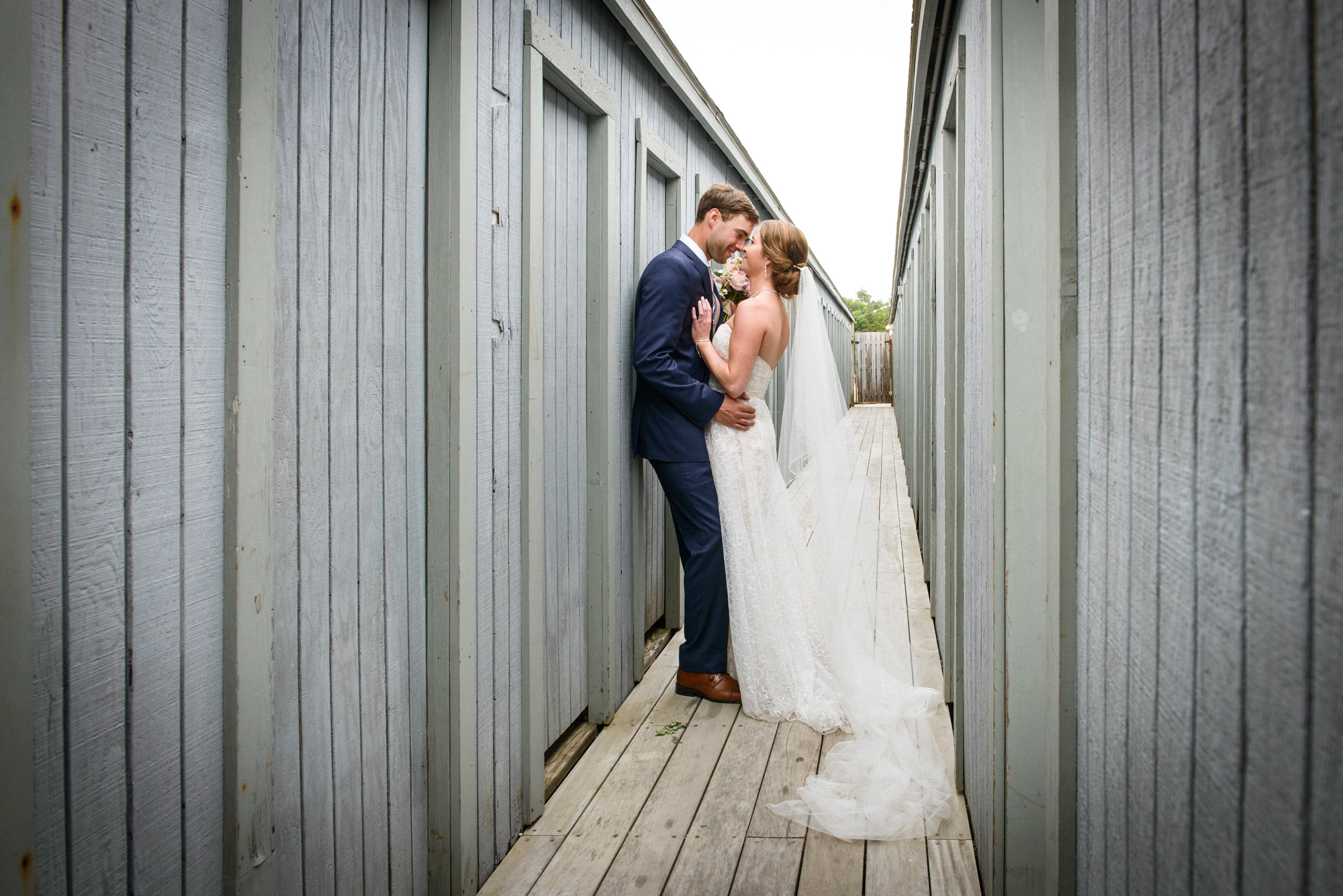 A bride and groom share a moment at the East Chop Beach Club  photo by David Welch Photography