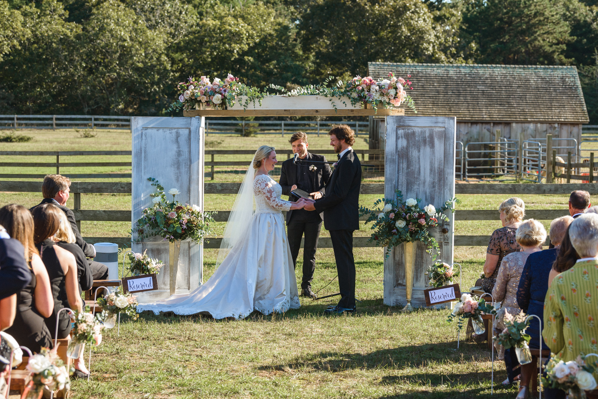 A wedding ceremony at Island Alpaca Company photo by David Welch Photography