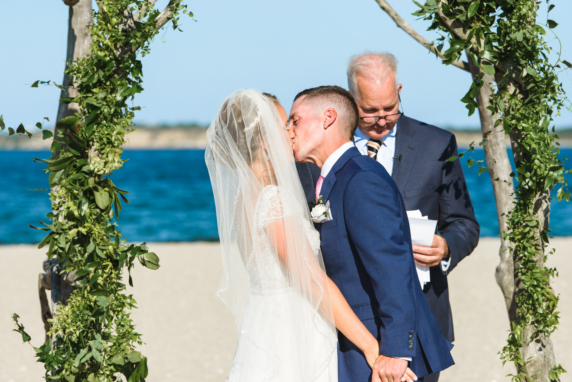 Cheers to the newlyweds married near the Edgartown Lighthouse photo by David Welch Photography