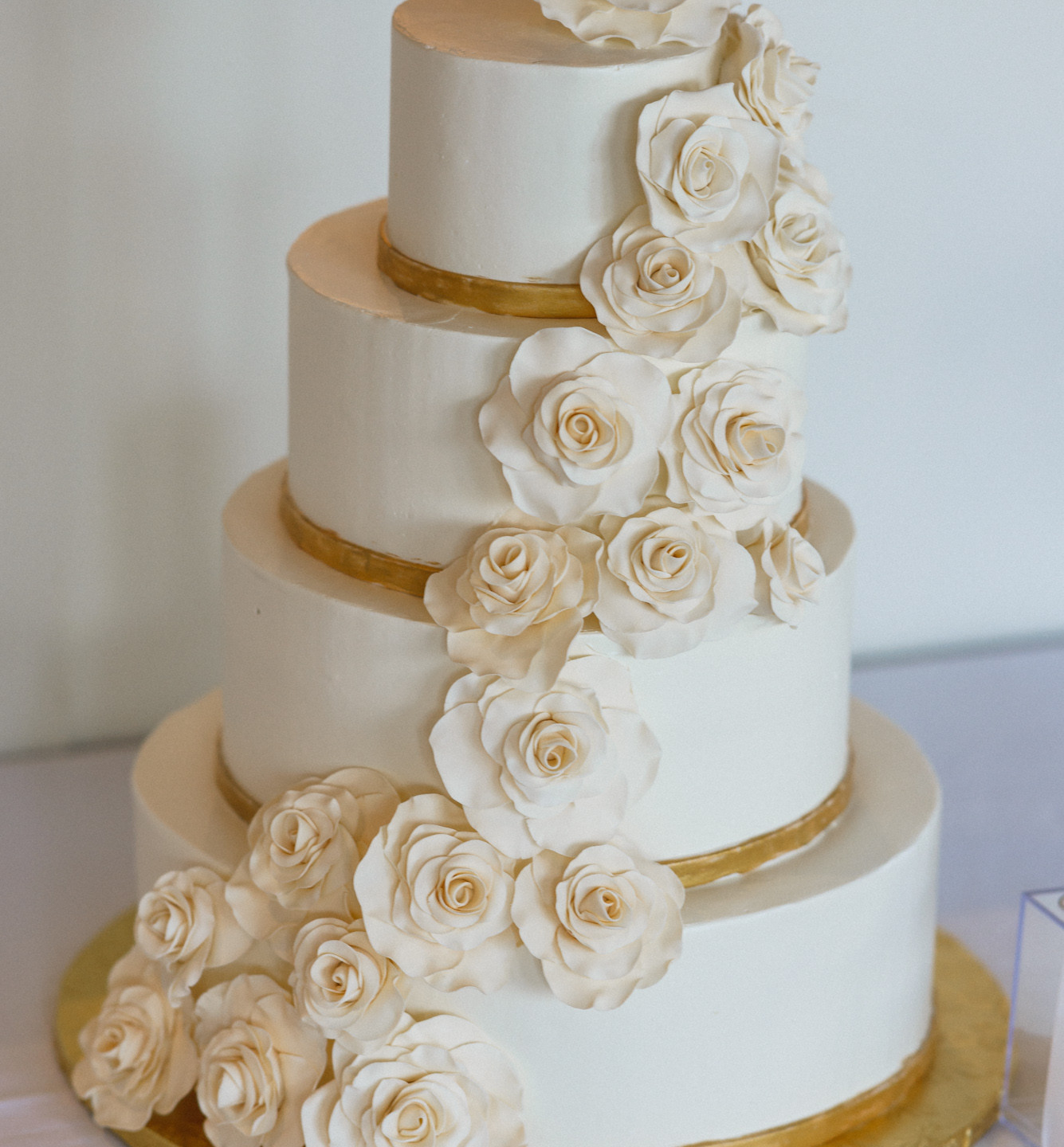 A ornate wedding cake at the Winnetu Oceanside Resort  photo by David Welch Photography