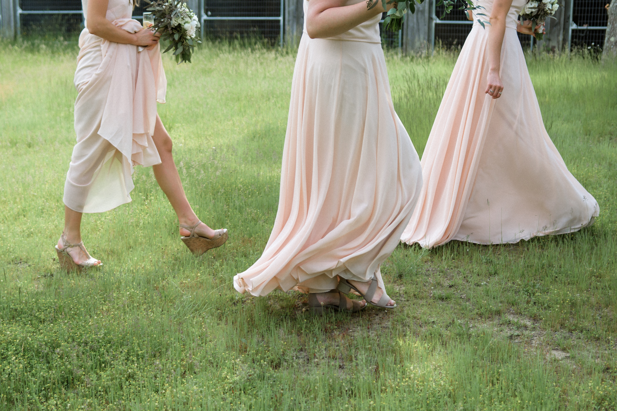 A unique photo of bridesmaids at the Martha's Vineyard Agricultural Hall in West Tisbury photo by David Welch Photography
