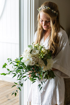 A bride and her bridal bouquet photo by David Welch Photography