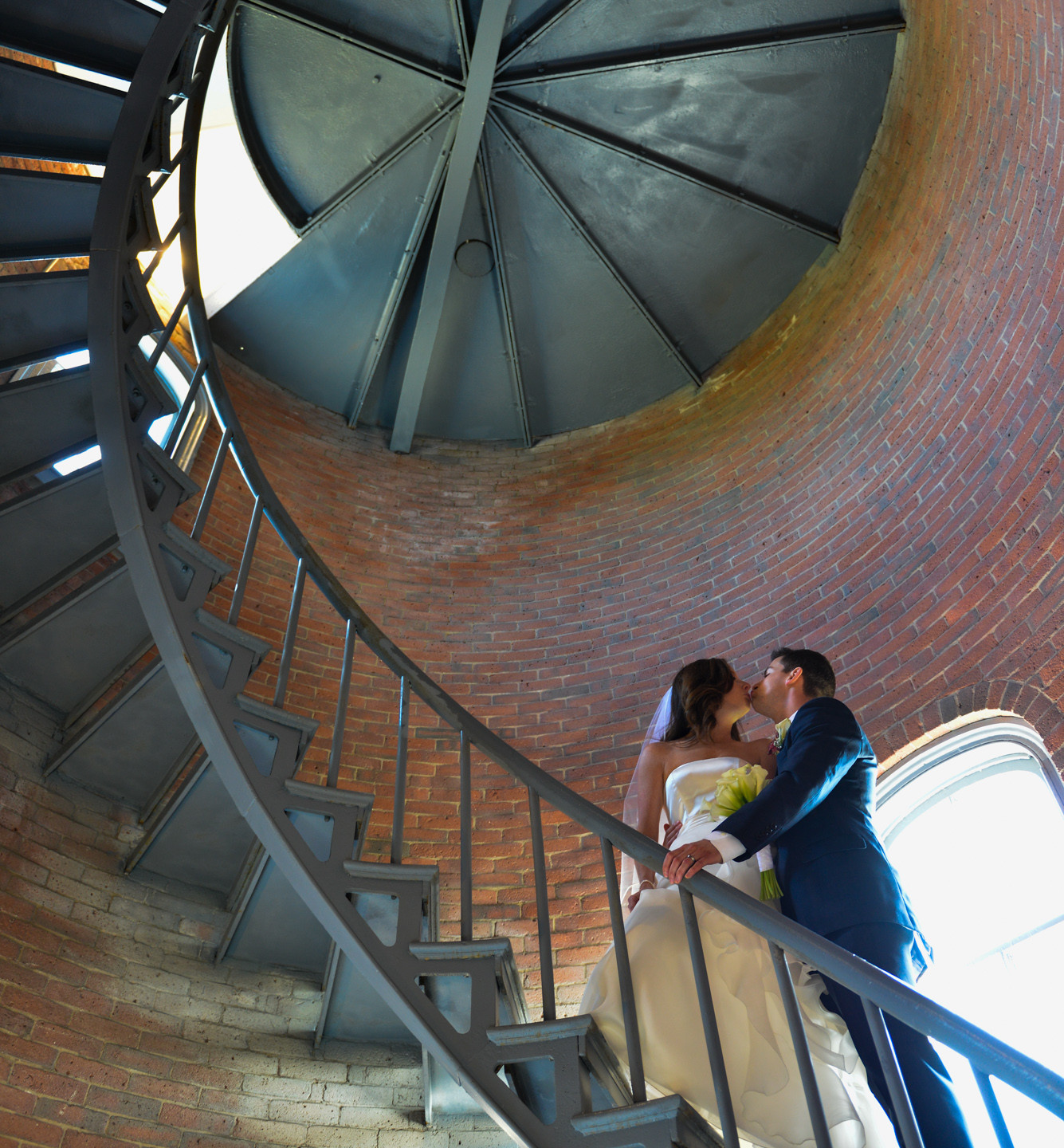 A bride and groom inside the East Chop Lighthouse photo by David Welch Photography