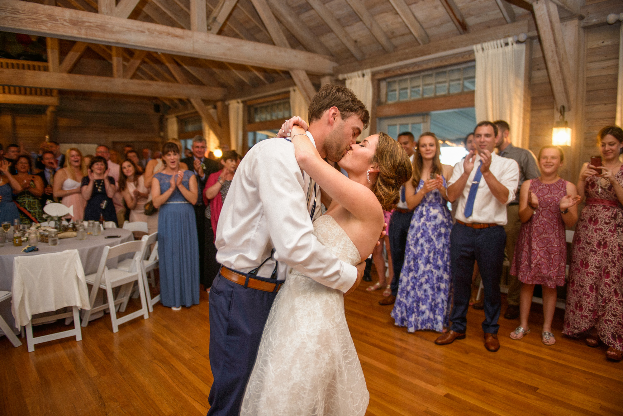 A bride and groom share their first dance at the East Chop Beach Club in Oak Bluffs photo by David Welch Photography