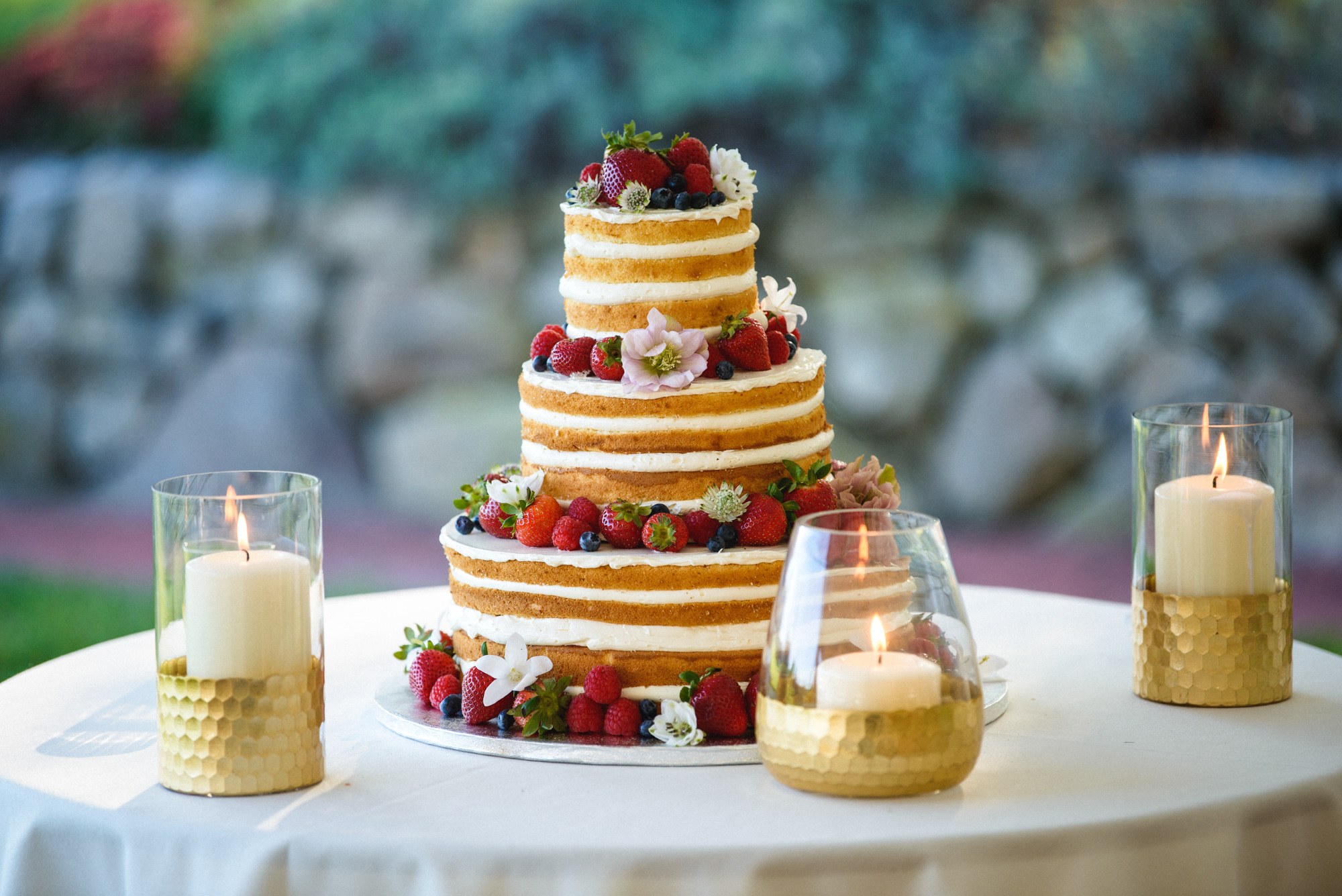 A unique wedding cake on display at Farm Neck Golf Club  photo by David Welch Photography