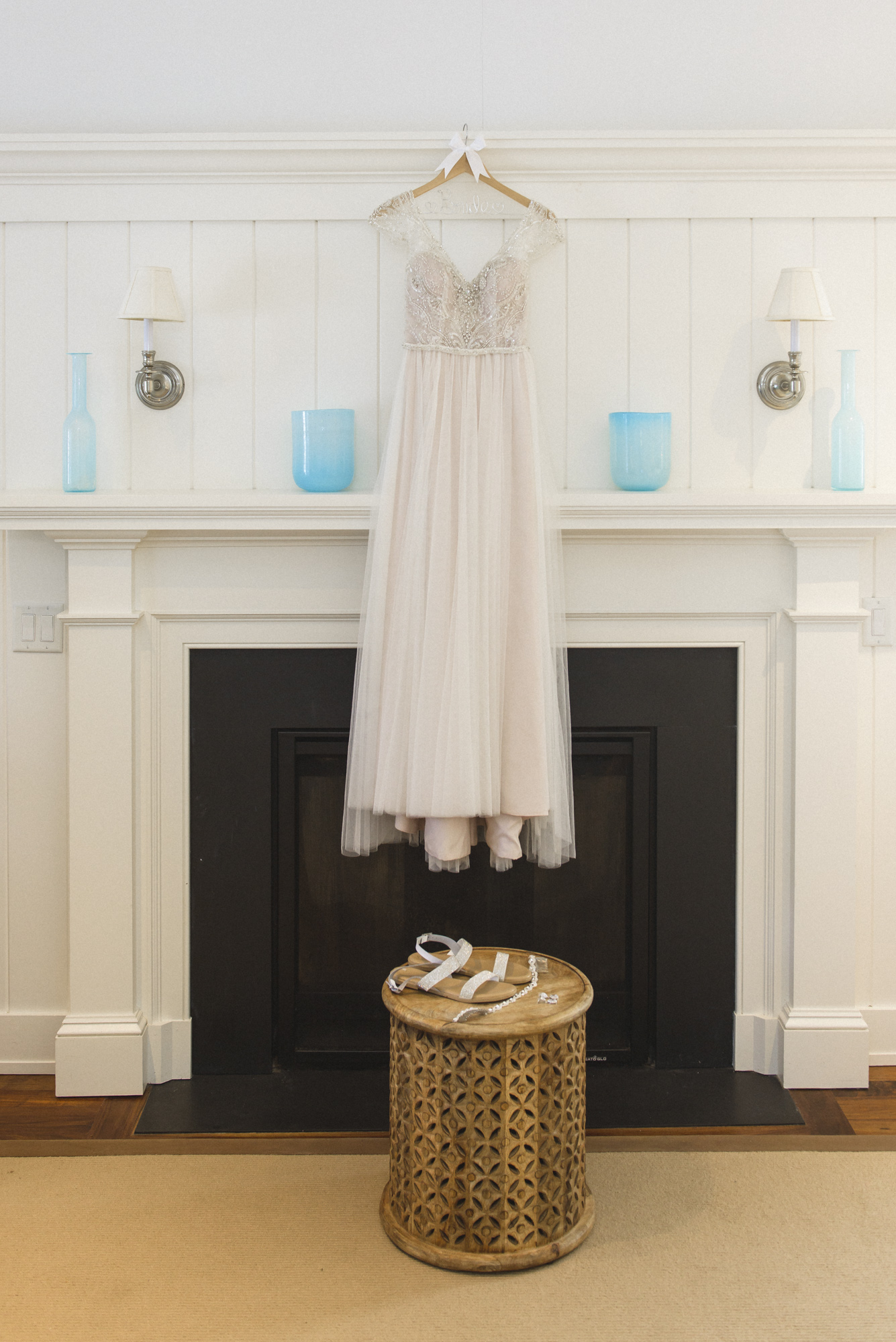A bride's dress hanging in her suite at the Harbor View Hotel photo by David Welch Photography