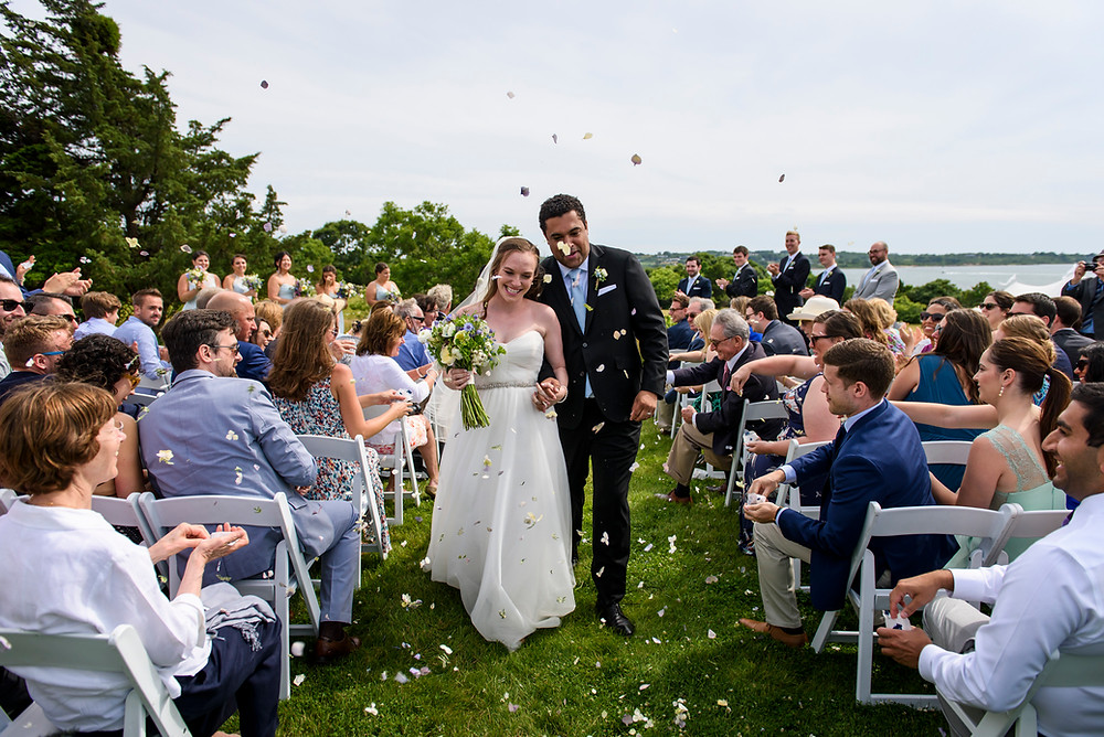 A bride and groom exit their wedding ceremony on Martha's Vineyard photo by David Welch Photography