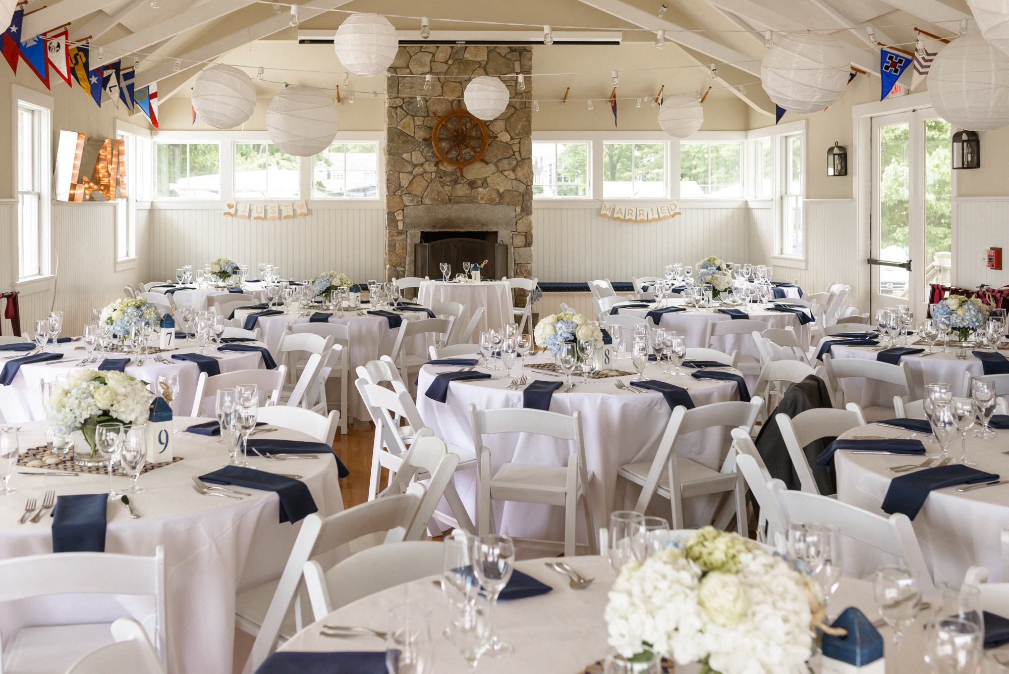 A wedding reception setup at the Vineyard Haven Yacht Club photo by David Welch Photography